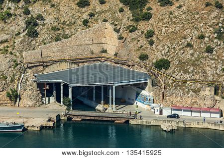 Sevastopol, Russia - June 09, 2016: Entrance to the former submarine Soviet navy base in Balaklava bay. Now Military-Historical Museum of fortifications.