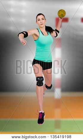 Female athlete with elbow pad throwing handball against digital image of handball goal