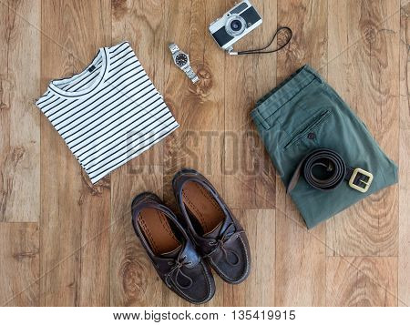 Collection of traveler clothes and objects parquet