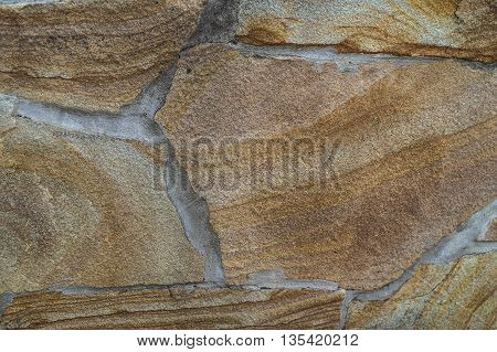 Path lined brown stone texture for background