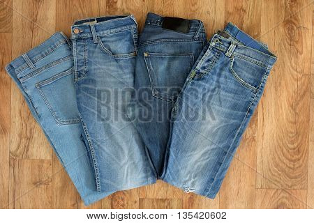 Top View Of Blue Jeans Isolated On Wooden Background