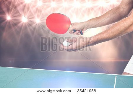Male athlete playing table tennis against flash light