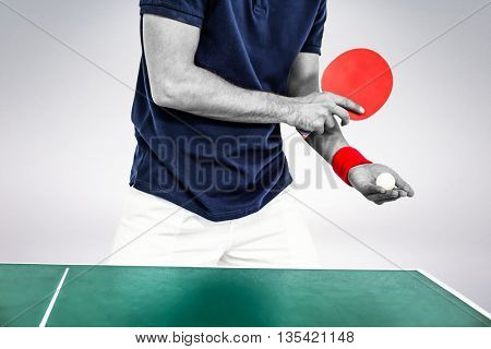 Mid section of athlete man playing table tennis against grey background
