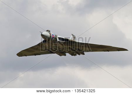 HEADCORN, UK - AUGUST 15: A vintage Avro Vulcan bomber passes down the flight line at Headcorn aerodrome for the public to watch on August 15, 2015 in Headcorn