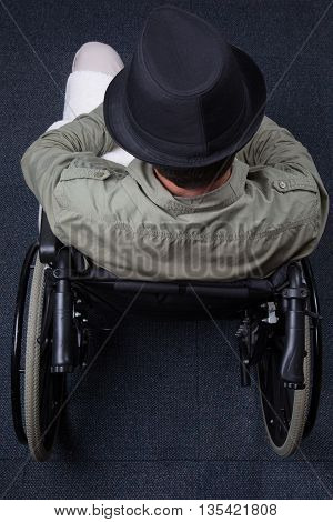 Senior Man On A Wheelchair Flat Lay, With A Hat