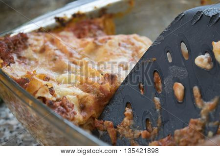 leftovers of bolognese style lasagne in a glass bowl