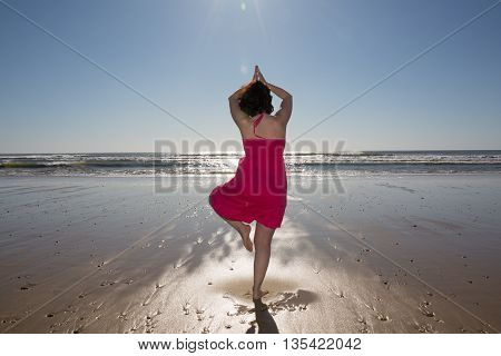 Woman Standing On A Sandy Beach Yoga Beach