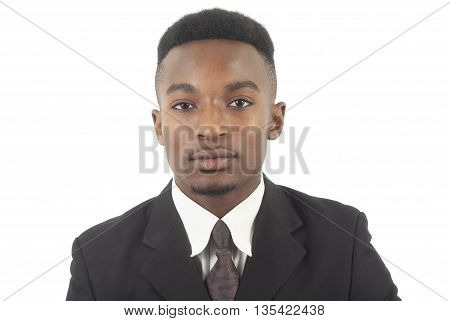 serious young black businessman in suit and tie on white background