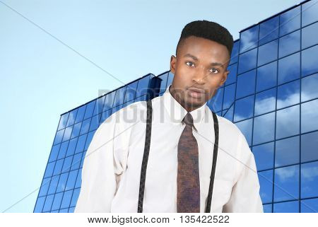 businessman wearing white shirt and suspenders in front of a blue building