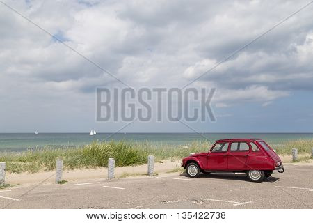 Tisvilde, Denmark - June 20, 2016: A Citroen 2cv Dyane standing on the parking lot of Tisvilde beach.
