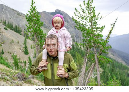Hiking Father And Little Girl On His Shoulders