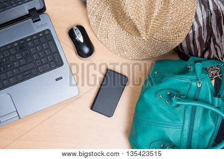 Business Woman Sitting At Her Desk Book Air And Hotel