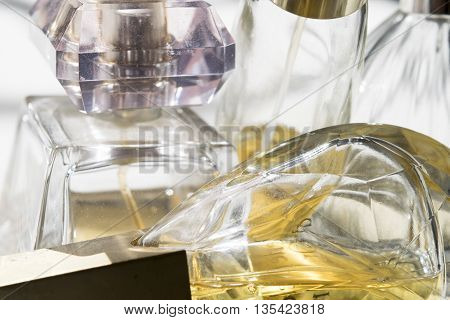 detail of some glass perfumed perfume bottles