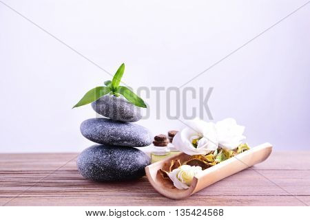 Spa composition with gray stones on light background