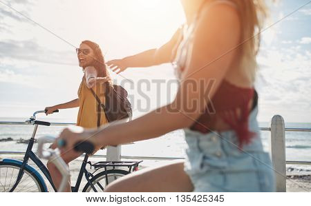 Two Friends Out For A Bike Ride On Sunny Day