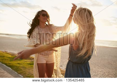 Young Women Enjoying A Day On The Beach And Having Fun