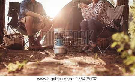Couple Sitting In Chairs Outside The Tent