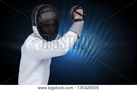 Man wearing fencing suit practicing with sword against black glowing design