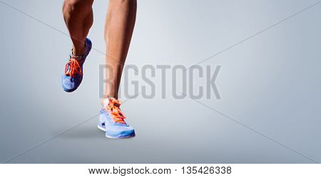 Close up of sportsman legs walking on a white background against grey vignette