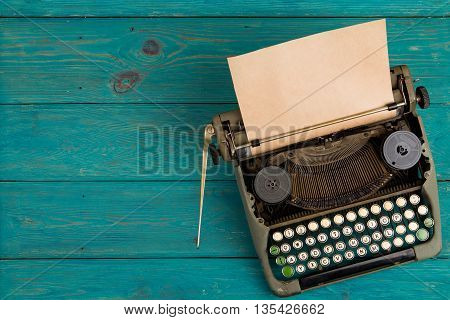 Typewriter On The Blue Wooden Desk