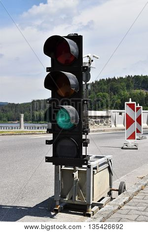 Mobile road semaphore. Mobile traffic light at roadside