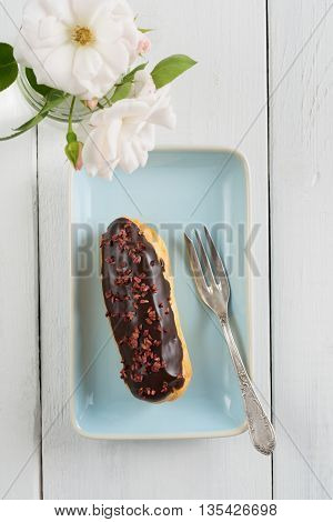 Eclair with chocolate ganache with raspberry topping