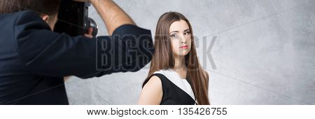 Beautiful woman and photographer during photo session panorama