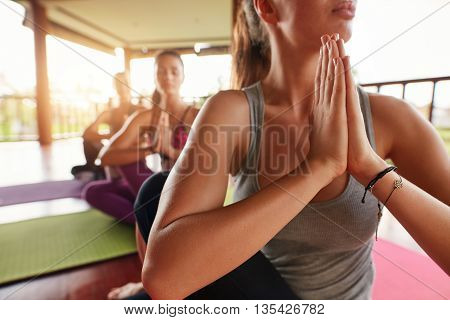 Young Woman In Yoga Class