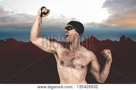 Swimmer posing with gold medal against composite image of landscape