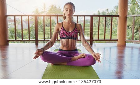 poster of Fit Young Woman Meditating
