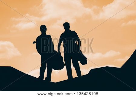 Men carrying golf equipment against cloudy sky