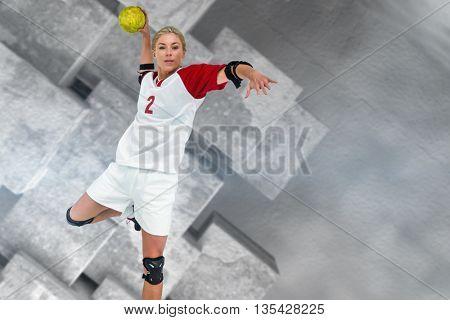 Sportswoman throwing a ball against grey tile design