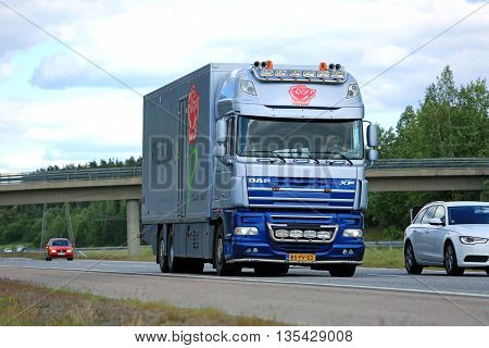 KAARINA FINLAND - JUNE 12 2016: DAF XF Flower transport semi truck moves along motorway among traffic in south of Finland.
