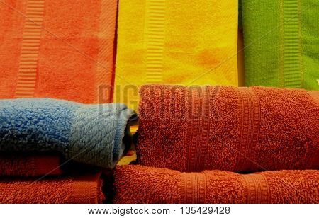 Stacks of colorful folded towels on wiper cloths background
