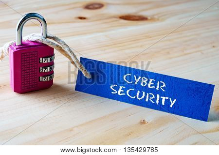 Words Cyber Security Written On Tag Label Tied With A Padlock.