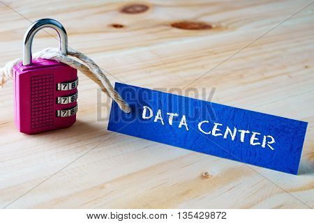 Words Data Center Written On Tag Label Tied With A Padlock.