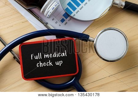 Medical Conceptual.stethoscope On Wooden Table With Word Full Medical Check Up.