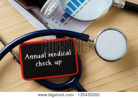Medical Conceptual.stethoscope On Wooden Table With Word Annual Medical Check Up.