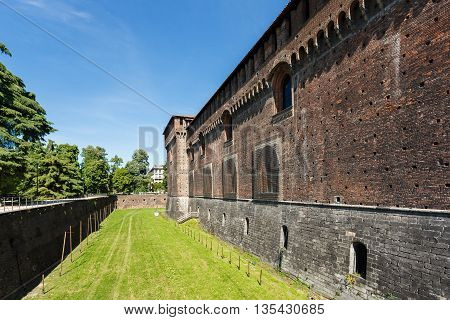 Milan Italy - May 04 2016: The brick wall of the Sforza Castle famous historical attraction of the city spring time