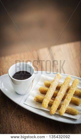 churros and chocolate spanish donuts pastry doughnuts with sauce breakfast snack