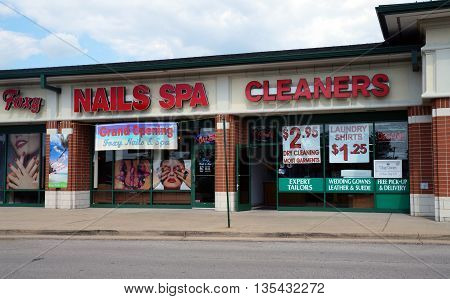 NAPERVILLE, ILLINOIS / UNITED STATES - JULY 23, 2015: One may have one's nails trimmed at the Foxy Nails & Spa, and have one's clothes cleaned at the Village Cleaners, in a Naperville strip mall.