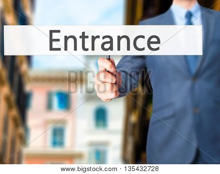 Entrance - Businessman Hand Holding Sign