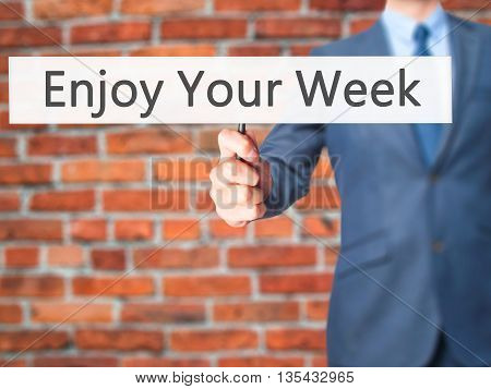Enjoy Your Week - Businessman Hand Holding Sign