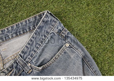 Blue jeans on a Artificial Grass background