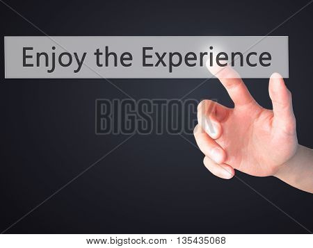 Enjoy The Experience - Hand Pressing A Button On Blurred Background Concept On Visual Screen.