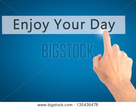 Enjoy Your Day - Hand Pressing A Button On Blurred Background Concept On Visual Screen.