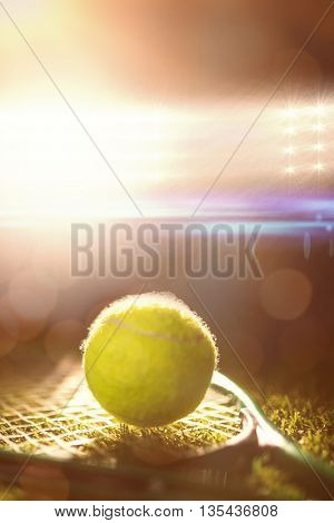 Close up of tennis ball and racket on the grass