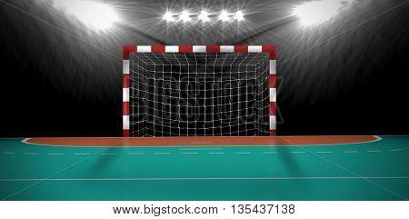 Composite image of a handball goal in an indoor stadium