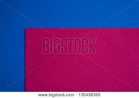 Eva foam ethylene vinyl acetate sponge plush pink surface on blue smooth background