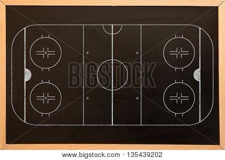 Sport field plan against blackboard with copy space